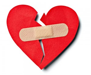 This is an image of a broken heart with a bandaid