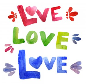 This is the image of the word love written three times with colorful finger-paints