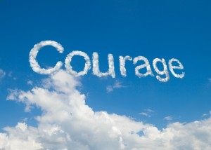 This is an image of a bright blue sky with beautiful clouds with the the word Courage written into the clouds