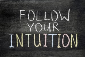 "This is an image of a chalkboard with colorful chalk that says, ""Follow Your Intuition"""