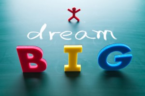"Image of a stick figure with the words, ""Dream Big"" in the foreground"