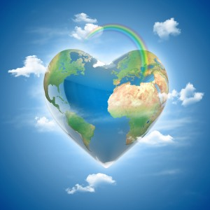 this is an image of a heart-shaped earth with clouds and a rainbow symbolizing world peace