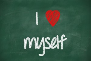 "This is the image of a green chalkboard with writing that says, ""I love myself"""