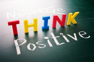 This is an image of the word negative crossed out and the the words Think Positive displayed