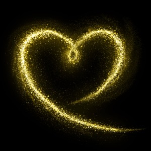 This is the image of a gold, glitter heart on a black background