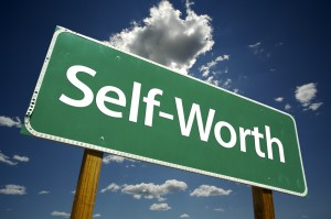 Image of large road sign against a background of blue cloudy sky that says SELF-WORTH