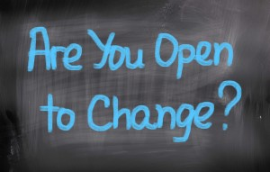 This is the image of a blackboard with blue chalk writing asking if you are open to change.