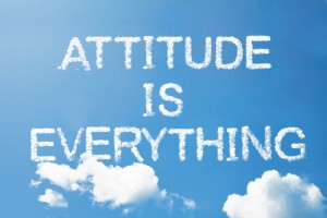 "This is the image of a lovely blue sky with clouds with the words ""Attitude is Everything"" in cloud font"